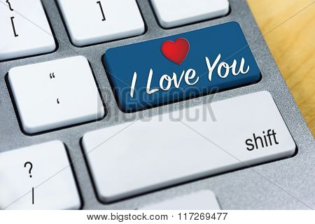 Written word I Love You and Heart Shape on blue keyboard button. Valentine's Day and Love Concepts
