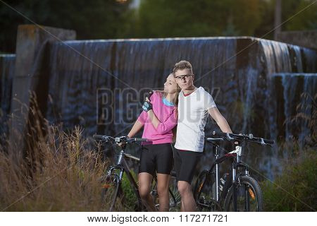 Sportive Caucasian Couple With Mtb Bicycles Dating Outdoors. Together With Mtb Bikes