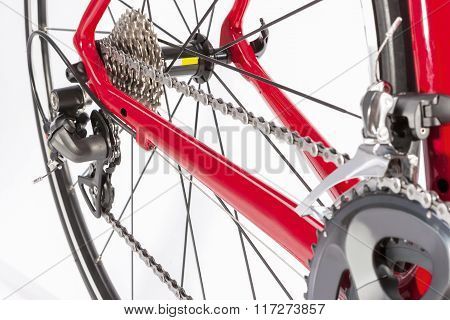 Bicycle Concept. Crankset And Rear Cassette With New Chain. Against White