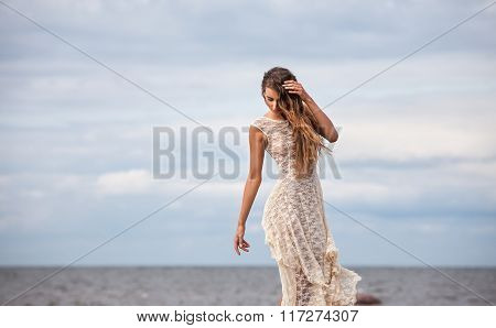 Girl In A Semitransparent Dress Against The Sea