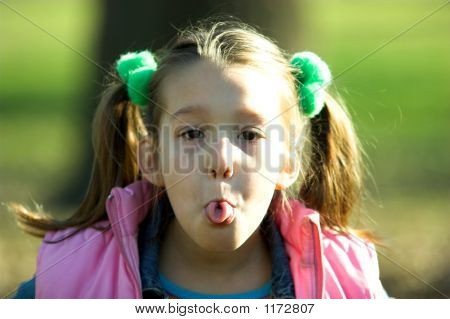 A Little Child Sticking Out Tongue