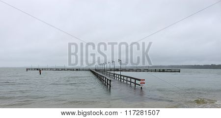 flooded fishing pier
