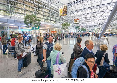 DUSSELDORF, GERMANY - SEPTEMBER 20, 2014: passengers at Dusseldorf Airport. Dusseldorf Airport is the third largest airport in Germany after Frankfurt and Munich