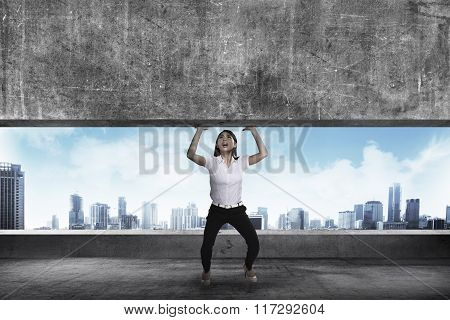 Asian Business Woman Lift Heavy Block