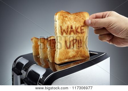 Good morning wake up toasted bread slice in a toaster, motivation to get started