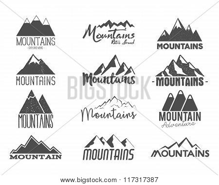 Set of Hand drawn mountains badges. Wilderness old style typography labels. Letterpress Print Rubber