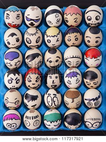 Children's Craft Of Faces Drawn On Eggs