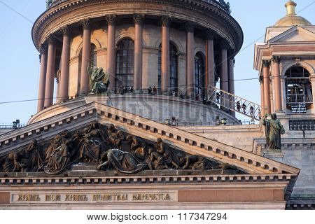 ST. PETERSBURG, RUSSIA - JANUARY 5, 2016: Tourists on the colonnade of St. Isaac's cathedral. Bas-relief