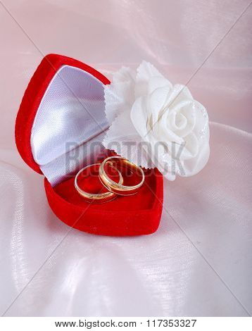 Two Wedding Rings In Red Case And A Rose