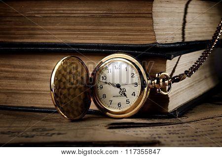 Vintage Pocket Clock And Old Books