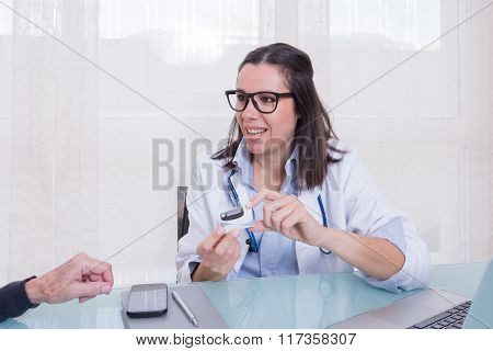 Doctor Showing Patient New Medical Device