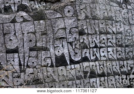 Ancient Buddhist Carved Stone Wall With Sacred Religious Mantras Written In Tibetan Language,Nepal