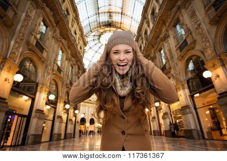Woman In Galleria Vittorio Emanuele Ii Rejoicing Start Of Sales