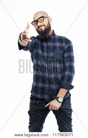 Smiling cool bearded african man in glasses standing and pointing to camera
