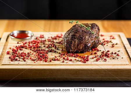 Beautiful Juicy Well Done A Piece Of Meat With Sauce On A Wooden Table