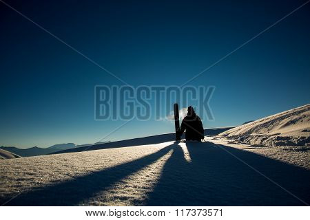 Male Skier Carries Skis In The Snow On Winter Day At The Ski Resort In Georgia