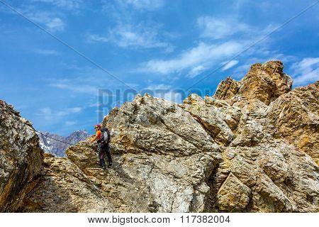 Male climber on rocky ridge