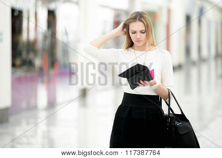 Young Female Out Of Money Checking Her Purse In Disbelief