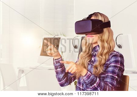 Pretty casual worker using oculus rift against computers and headsets