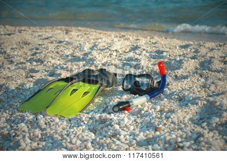 Mask, Snorkel And Fins For Snorkeling On A Sandy Beach.