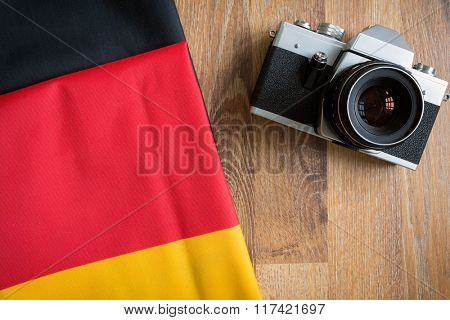 top view Germany flag and retro photo camera background