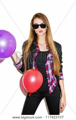 Modern teenage girl in black with sunglasses and balloons