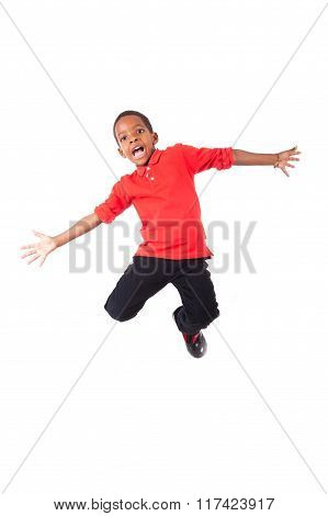 Portrait Of A Cute African American Little Boy Jumping, Isolated On White Background