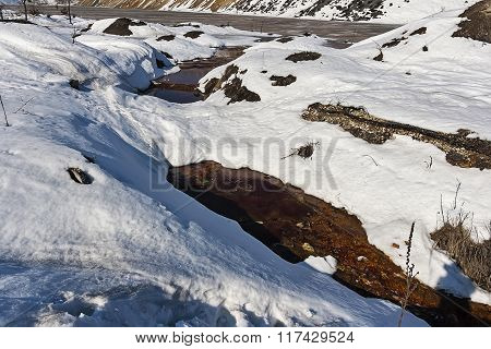 Poluted River Under Snow