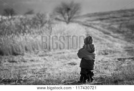 Young Happy Boy Playing Outdoor. Black And White Photo.