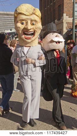 Hillary Clinton Links Arms With The Monopoly Man At Mardi Gras