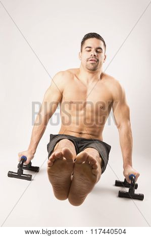 Strong beautiful man doing sport