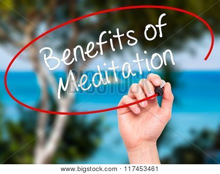 Man Hand Writing Benefits Of Meditation With Black Marker On Visual Screen.