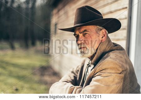 Sitting Pensive Senior Western Man Looking Afar