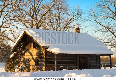 Snow Cabin In The Winter