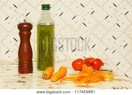Bottle Of Oil, Pepper Mill, Carrot And Tomato.