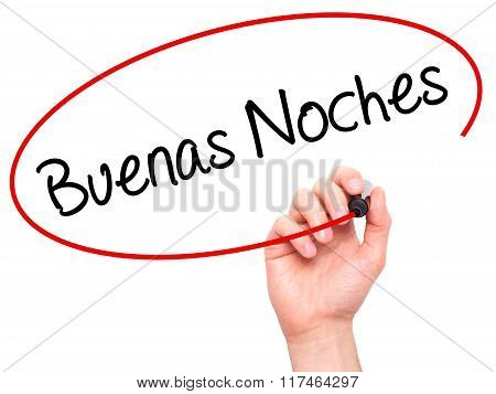 Man Hand Writing Buenas Noches (good Night In Spanish) With Black Marker On Visual Screen.