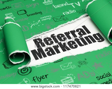 Marketing concept: black text Referral Marketing under the piece of  torn paper