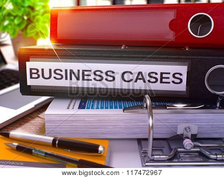 Business Cases on Black Ring Binder. Blurred, Toned Image.