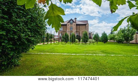 Manicured House And Garden
