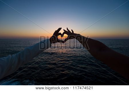 Silhouette Of Heart From Two Hands