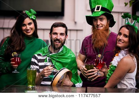 Friends celebrating St Patricks day with drinks in a bar poster