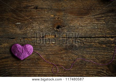 Purple Heart On On Old Shabby Wooden Background