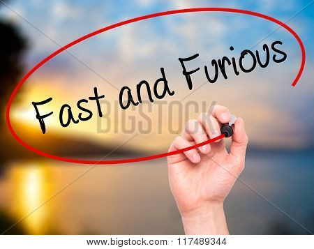 Man Hand Writing Fast And Furious With Black Marker On Visual Screen