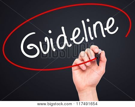 Man Hand Writing Guideline With Black Marker On Visual Screen