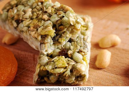 Granola Bar On Wooden Board With Dried Fruits And Nuts
