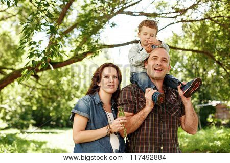 Happy Family Outdoors Walking In Summer