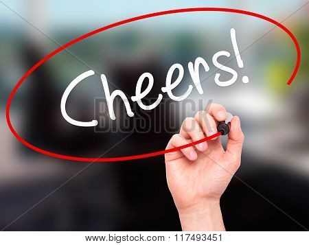 Man Hand Writing Cheers! With Black Marker On Visual Screen