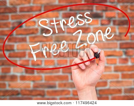 Man Hand Writing Stress Free Zone With Black Marker On Visual Screen