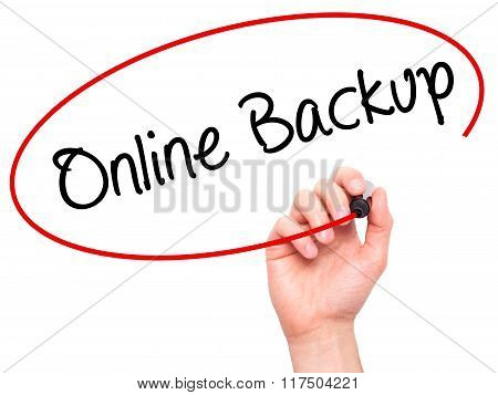 Man Hand Writing Online Backup With Black Marker On Visual Screen.