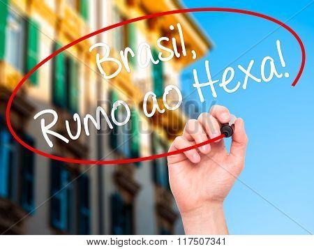 Man Hand Writing Brasil, Rumo Ao Hexa! With Black Marker On Visual Screen.